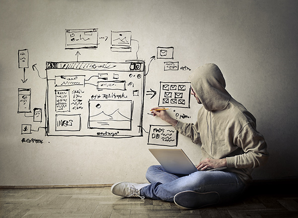 What is the difference between web design and web development, a young man with a computer brainstorming ideas on a white background